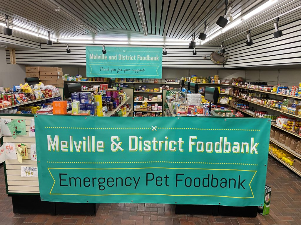 MDFB's new sign hanging on display which highlights the fact that they are only one of eight food banks in Saskatchewan that hands out pet food!